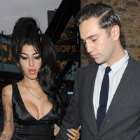 Amy Winehouse Was 'Secretly Engaged' To Reg Traviss