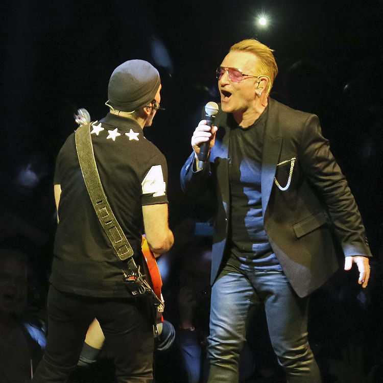 U2 bring fan on stage to perform In Gods Country Phoenix