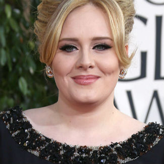 Adele convinced to make permanent move to LA by Robbie Williams?
