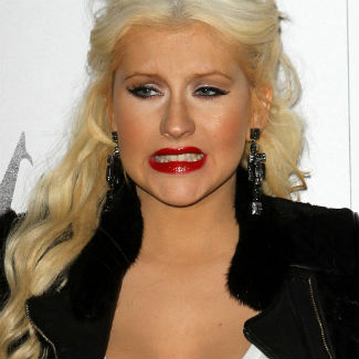 Christina Aguilera calls Simon Cowell 'a d*ck'