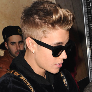 Concussed Justin Bieber collapses backstage - watch