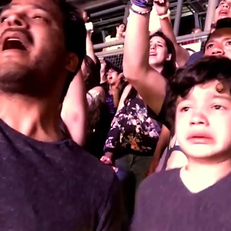 Young autistic boy is overcome with emotion during coldplay concert