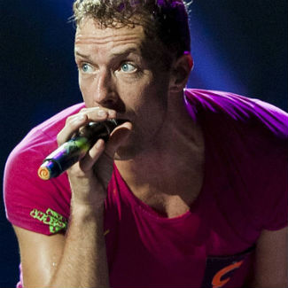 Rihanna joins Coldplay onstage in Paris to perform 'Umbrella' - video
