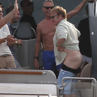 Elton John shocks Michael Caine with yacht bum flash