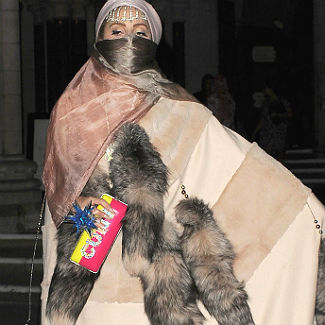 Lady Gaga threatened with faeces and paint after burqa costume