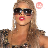 Lil Kim slams Drake, calls him 'a coward in Gangsta drag'