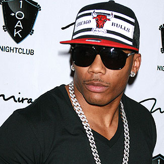 US rapper Nelly denies knowledge of gun and drugs found on tourbus