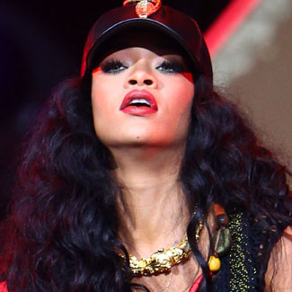 Rihanna brings her 'Umbrella' to close rain-lashed Wireless