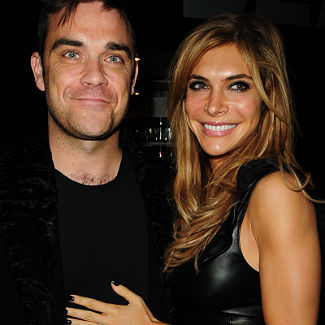 Robbie Williams 'rockin' afer birth of first child, Theodora Rose