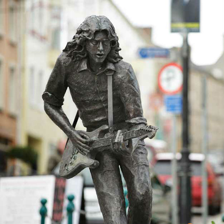 Rory Gallagher Strat Guitar songs statue Belfast best album Deuce