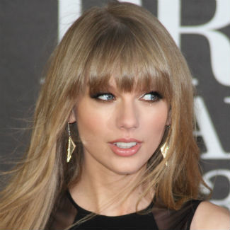 Taylor Swift fan arrested after swimming to her beach front home
