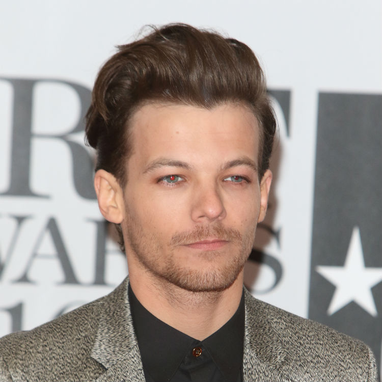 Louis Tomlinson One Direction changes number over Whatsapp abuse