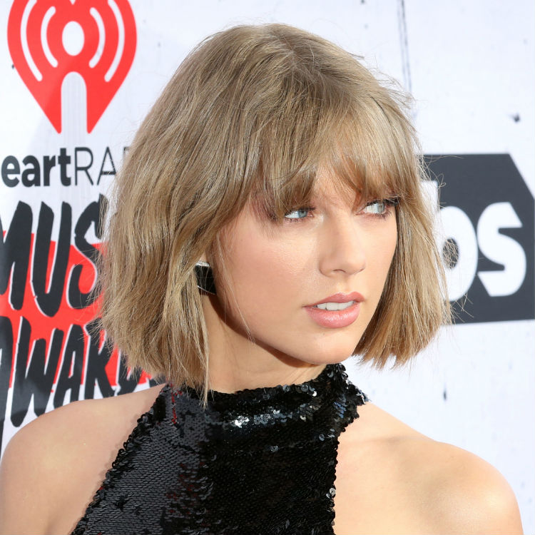 Taylor Swift thanks boyfriend Calvin Harris at the iHeartRadio Awards
