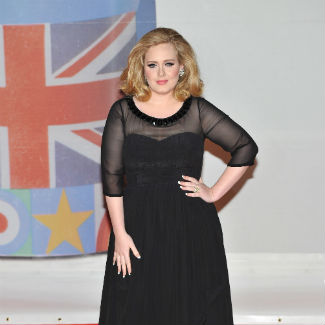 Adele 'over the moon' as she announces first pregnancy
