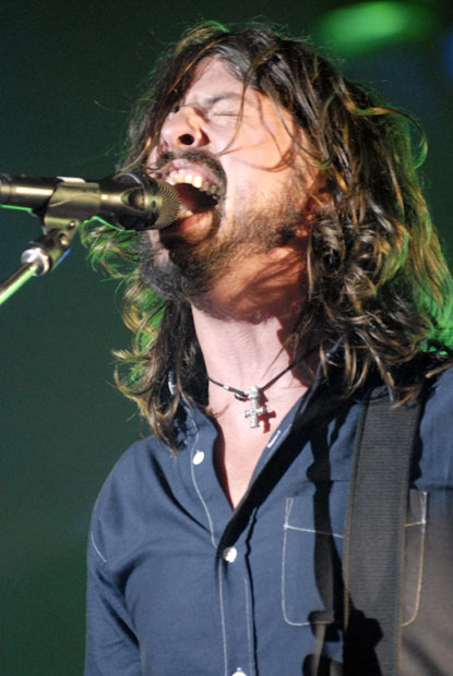 Dave Grohl of the Foo Fighters reaches, um, Nirvana.