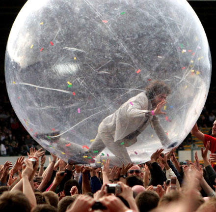 The Flaming Lips' Wayne Coyne is no stranger to props, but his giant crowd-surfing ball has now become his trademark at festivals and concert halls with high ceilings!