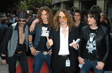 20. The Darkness - No, it wasn't a bad nightmare. Justin Hawkins, he of tight catsuits and rebellious teeth fame, really did headline the Reading and Leeds festivals with The Darkness. Essentially joke mock-rockers who benefited by a temporary loss of irony awareness, this band from Lowestoft pillaged the deepest atrocities of 80's hair metal and regurgitated them over a series of tongue in cheek songs like 'I Believe In A Thing Called Love' and 'Growing On Me'. Luckily the band have split now with Justin Hawkins going on to try various ventures such as entering Eurovision (Beaten by the car crash that was Scooch).