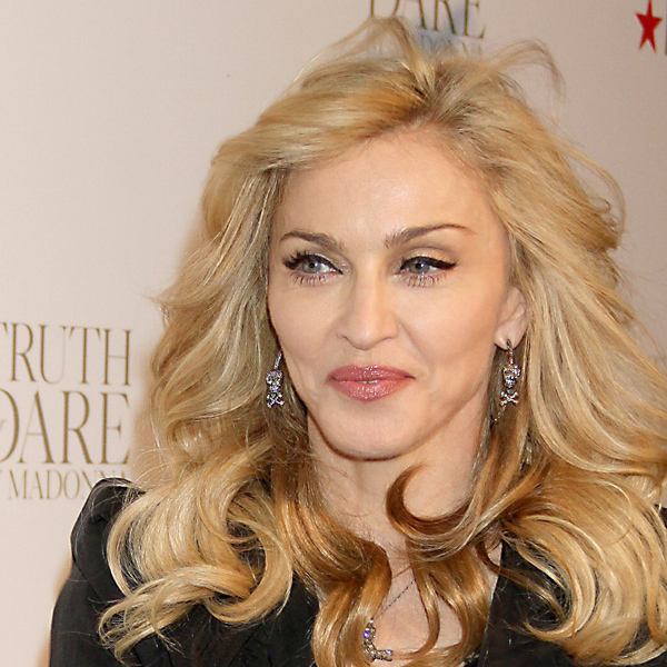 MADONNA infruriated the French National Front after showing a Swastika on the face of leader Marie Le Pen during her MDNA tour.
