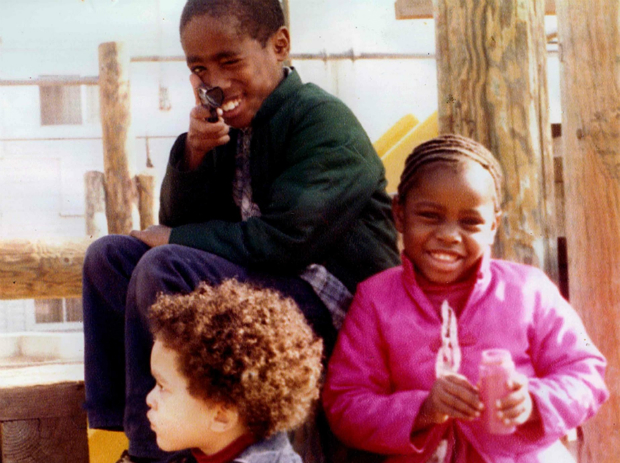 Tupac as a child with his step-siblings.