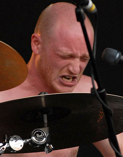 Biffy Clyro drummer Ben Johnston in the throes of playing his instrument