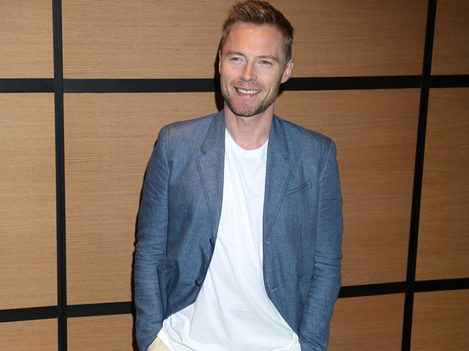 Boyzone frontman Ronan Keating escaped the clutches of a drunken stranger attempting to pick him up off his feet at Isle Of Wight Festival - with a little help from security guards. The drunk was said to have wanted to give Ronan ''a hug''.