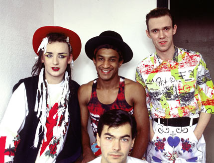 Boy George, Mikey Craig, Roy Hay and Jon Moss of Culture Club photographed backstage at a an Essex club gig the night before the band scored their first UK no1 hit with 'Do You Really Want To Hurt Me' in September 1982.