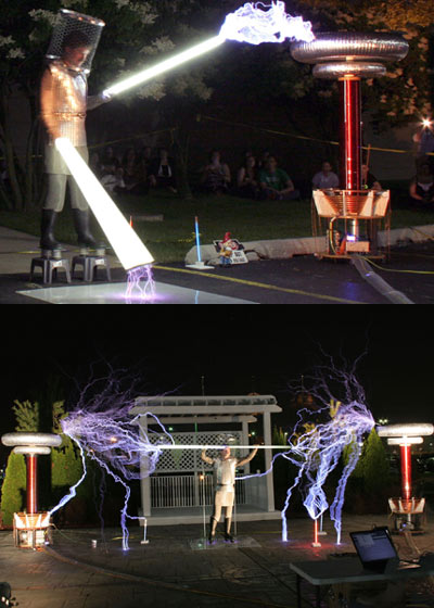 The self dubbed 'Master Of Lightning' Dr Zeus - real name Terry Blake. The daredevil wears a protective suit (complete with Wellington boots) to conduct electricity via light sabres and 12 kilowatt musical tesla coils. As well as creating 'music', it makes for a damn fine visual display, as these photos from a showing in Michigan prove.