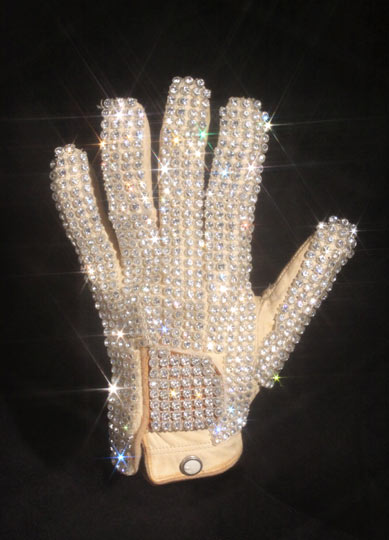 "Michael Jackson's glove from his 1983 performance of Billie Jean at the Motown 25 television special where he performed the Moonwalk for the first time.  The glove is completely different from the other gloves Jackson wore during this period.  It is made using a cream leather, off-the-rack golf glove with an interior label reading ""Made In Korea"