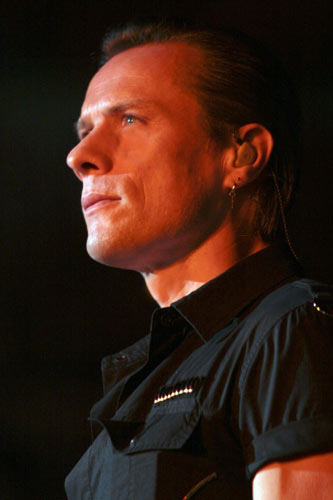 Larry Mullen looking out onto the crowd at the San Siro Stadium, Milan in late July 2005