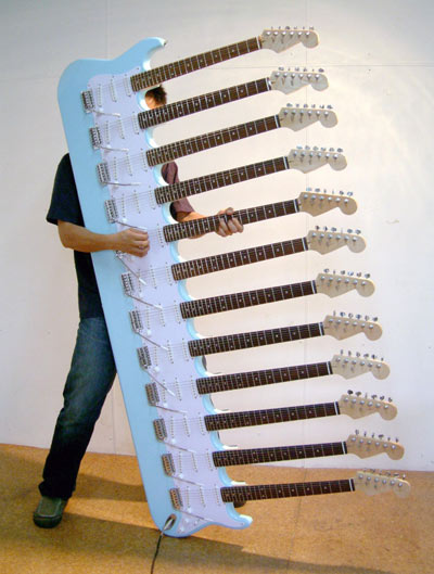 This astonishing, ridiculous 12 neck, 72 sting guitar was designed by Japanese artist Yoshihiko Satoh for a 2007 exhibition in Tokyo called Present Arms and Glory Arms. A fully functioning instrument, apparently.
