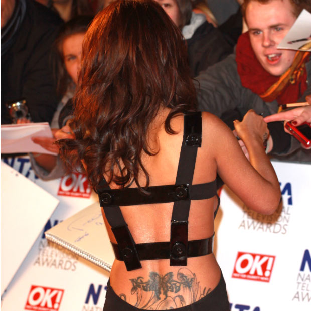 Cheryl Cole - The ink job heard around the world. We can only guess where this monstrosity goes, but it's bad enough we have to see the top half in all honesty.