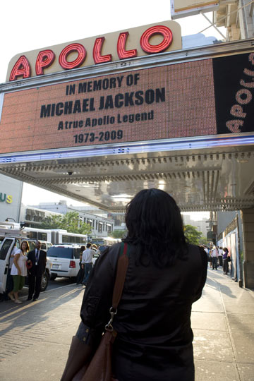 A fan looks at the Apollo Theatre's tribute to Michael Jackson in Los Angeles.