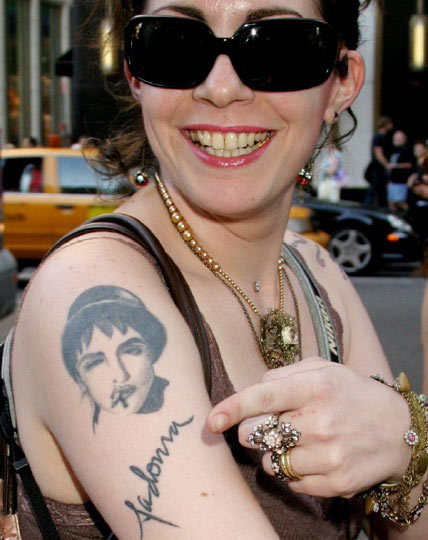 weird wacky and woeful tattoos of music stars photos gigwise. Black Bedroom Furniture Sets. Home Design Ideas