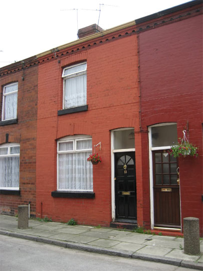 The tiny 12 Arnold Grove in Liverpool where George Harrison was born and brought up. Its current owners have resisted a series of attempts by Liverpool City Council to have a English Heritage placard placed outside the property. 