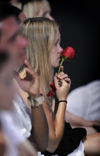 A fan of Michael Jackson holds a single rose at his tribute ceremony at the Staples Center.
