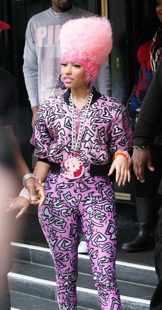 Nicki Minaj reveals new Marge Simpson-esque hair, only pink (of course), during her first visit to London.
