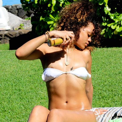 Rihanna - the shy and retiring (as if) star recently posted an entire gallery of her vacation in Hawaii on her Facebook page. Needless to say, she wasn't wrapped up for the photos...