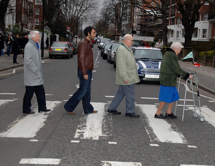 OAP group The Zimmers shuffle along Abbey Road after recording their charity single, a cover version of The Who's 'My Generation' in the studios.