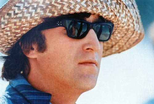 Looking cool as always in shades and a straw hat, a good way to remember the legend that is John Lennon.