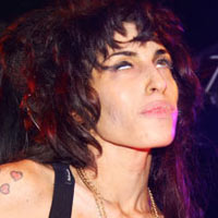Amy Winehouse 'Back In Hospital To Receive Extra Treatment'