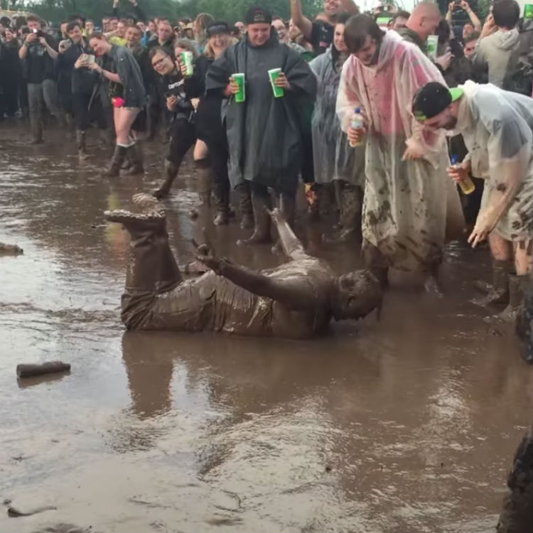 Download Festival bad weather, mud, man dives headfirst video