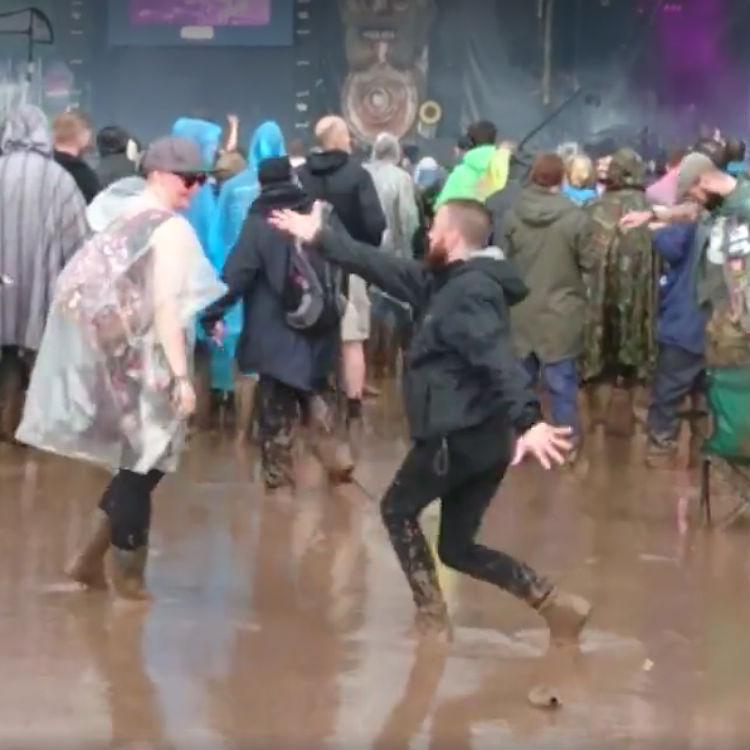 Download Festival rain, flood and mud dancing man video goes viral
