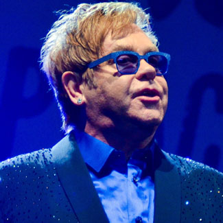 Elton John excited to see the fancy dress at Bestival
