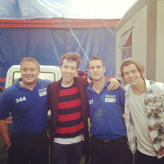 One Direction Harry Styles hangs out backstage at Reading Festival