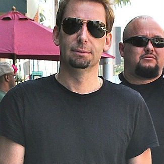 Sex machine Chad Kroeger 'reigns in libido' for Avril Lavigne