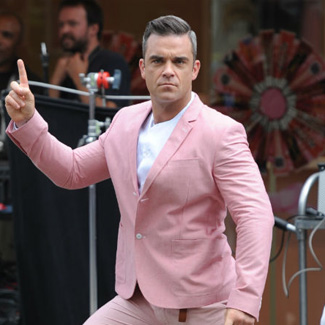 Robbie Williams makes comeback with new 'Candy' video - watch