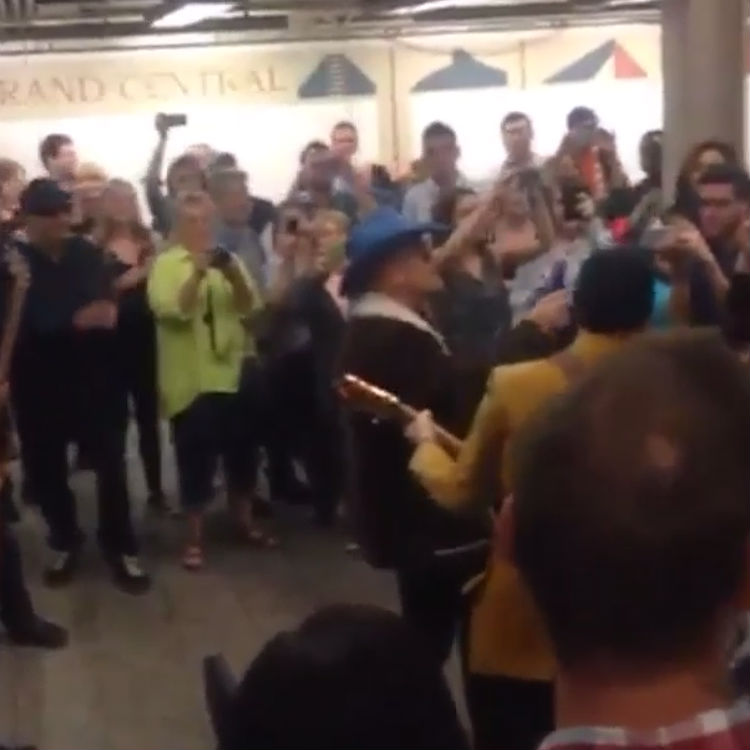Watch U2 busking on an NYC subway platform