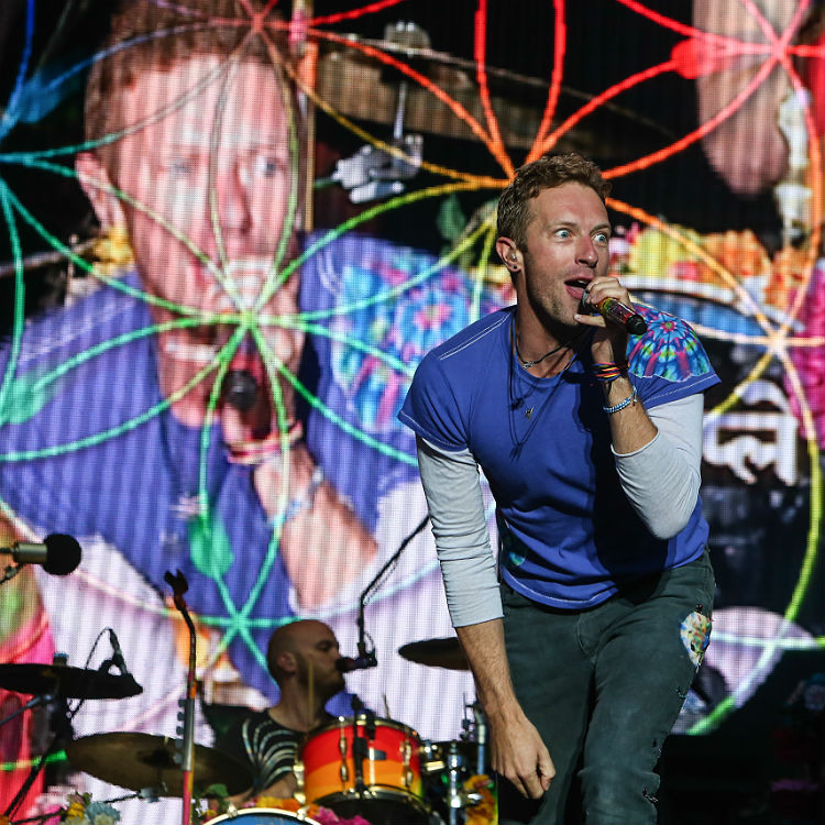 Coldplay hand out wristbands ahead of Glastonbury headline slot